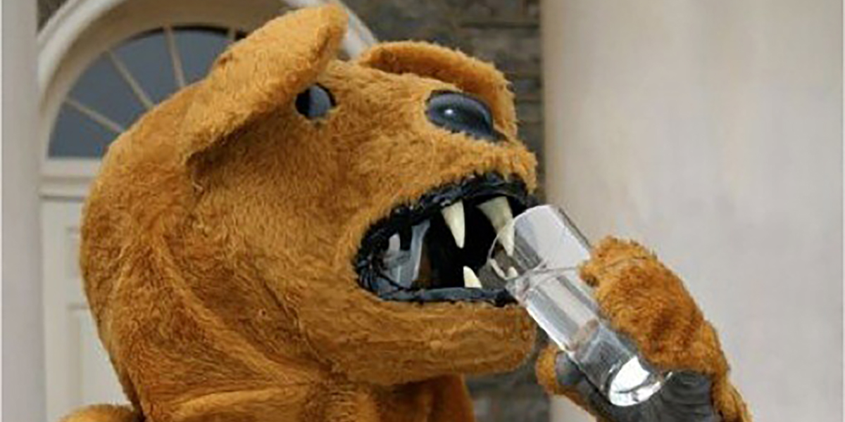 Nittany Lion mascot drinks water